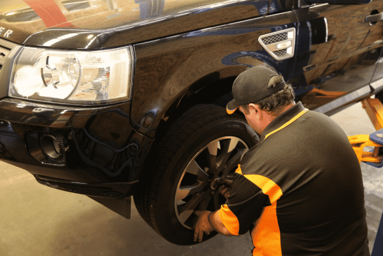 mechanic in wollongong putting on a tyre