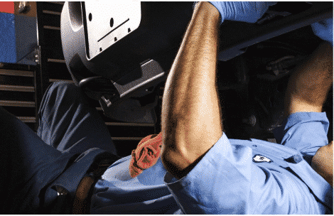 mechanic under a car