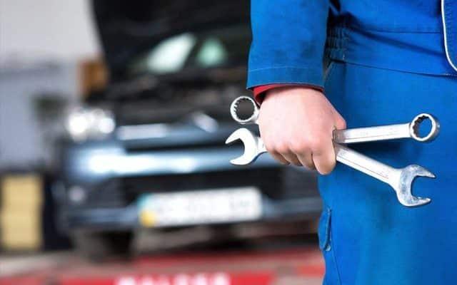 mechanic holding spanners