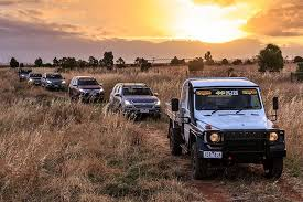 convoy of 4 wheel drive vehicles on tour