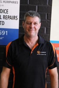 staff member with 1st choice mechanical repair shirt on